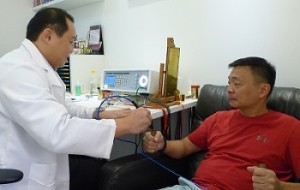 Therapist doing bioresonance treatment for patient