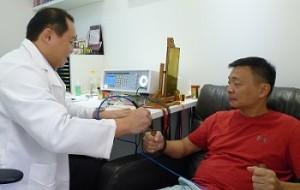 Therapist doing bioresonance treatment for patient